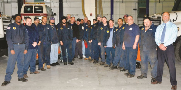 Pictured here are some of the City of Boston's 38 fleet staff members. Technicians at the City's...