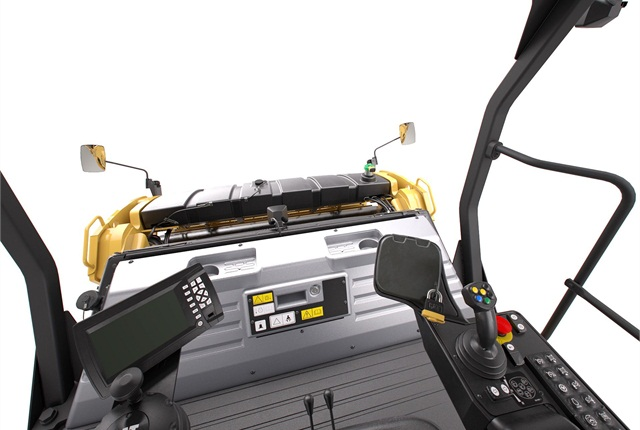The operator's control station comes with standard 180-degree seating and optional 360-degree positioning. A color display allows the operator to monitor areas of coverage and the number of passes made. Photo courtesy of Caterpillar