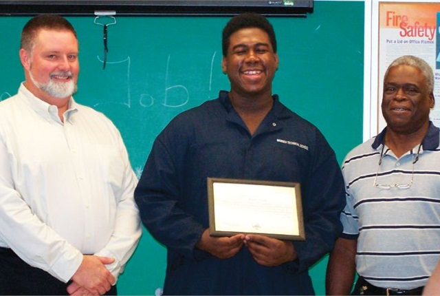 Kurwin Bruney (center) holds a certificate for attaining 200 hours of work-based learning with the DeKalb County, Ga., fleet. He is pictured with (left) Robert Gordon, fleet service superintendent, DeKalb County, and Warren Tech teacher Ed Anderson (right).