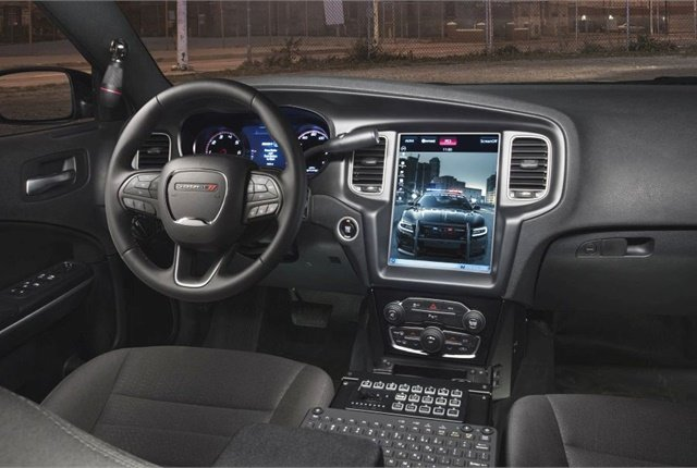 Dodge offers a built-in dash display system, Uconnect, to take the place of a laptop in the Charger's driver area. Photo courtesy of FCA
