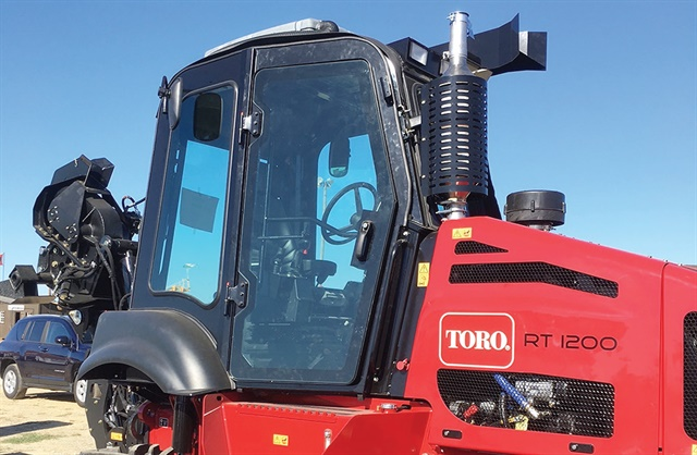 The newly available cab assembly for the Toro RT1200 riding trencher features a pressurization system that virtually prevents dust and debris from entering the operator's station. Photo courtesy of Toro