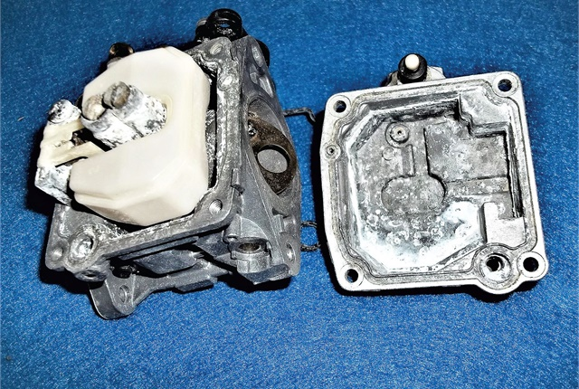 Ethanol can corrode some metals, such as the corrosion shown on this carburetor from the back-up pump of a utility.Photo courtesy of James Dunst
