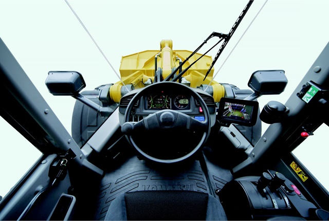 The Komatsu WA270-8 wheel loader cab includes a monitor offering Ecology Guidance, a rear-view monitor, auto-idle shutdown, an auxiliary jack, and two 12-volt ports. Photo courtesy of Komatsu