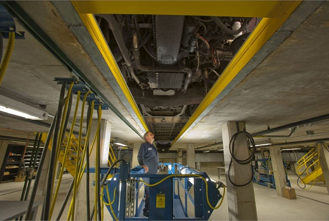 An advanced lower-level work area with a mobile platform allows technicians to move the length of the opening of the pit and raise and lower it as needed. Photo courtesy of MDG