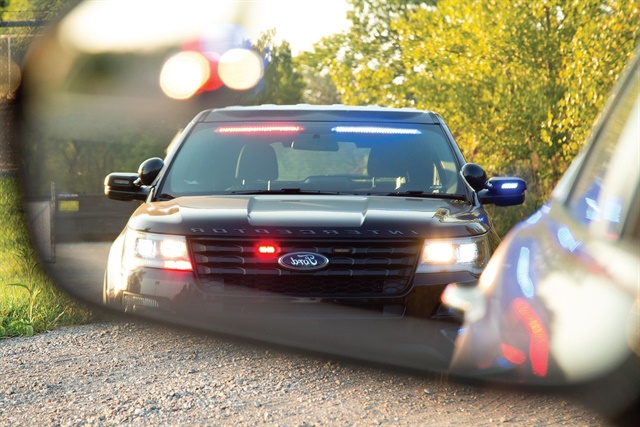 The new optional front interior visor light bar on the Ford Police Interceptor Utility flashes bright, alternating red and blue bars on top of the windshield. Photo courtesy of Ford