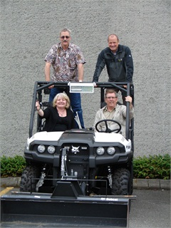 The Seattle fleet management team consists of (standing l-r) Michael 'Vini' Vincent, vehicle maintenance manager; Chris Wiley, fleet operations manager; (seated l-r) Nanci Lien, fleet administration manager; and Dave Seavey, director.