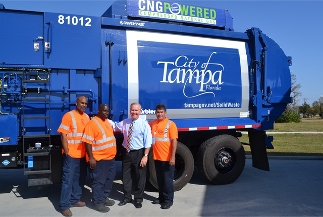 The City crew stands next to a new solid waste CNG vehicle with Tampa's Mayor Bob Buckhorn.