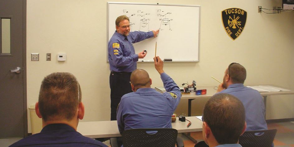 A technician presents a class to his peers, solidifying his knowledge of the subject while...