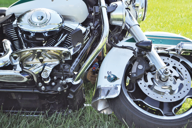 Motorcycles can offer cover and concealment in an emergency. If the bad guys can't see you, then...