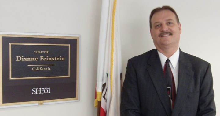 Battersby's advocacy for clean fuels brings him to the Energy Independence Summit in Washington, D.C, where he educates elected officials on the important roles that fleet and alternative-fuel vehicles play in our nation's future. In this photo from 2014, Battersby poses outside of California Senator Dianne Feinstein's D.C. office.