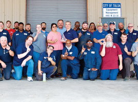 Members of the Tulsa Equipment Management Division celebrated their No. 1 designation. Administrative Manager Brian Franklin is pictured in the front row, second from right.