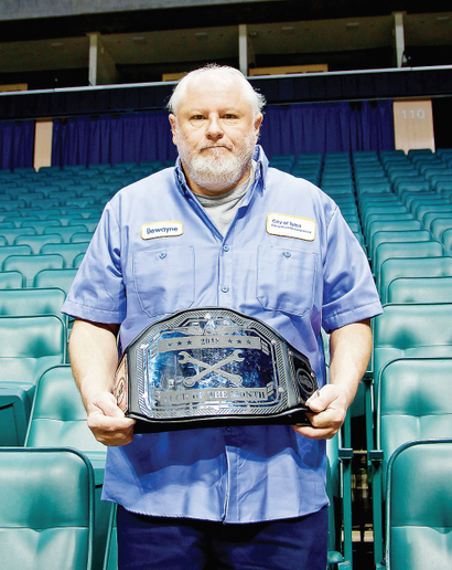 The fleet's Technician of the Month — Dewayne Chronister, autobody repairer — receives a traveling WWE-style wrestling belt and medallion.  - Photo courtesy of City of Tulsa