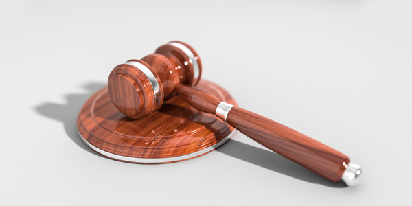 Photo of a judge's gavel and sound block via Pixabay