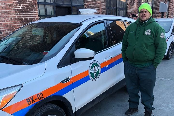 Benjamin Leon of the Department of Sanitation poses with a fleet vehicle fitted with an air quality monitoring device. - Photo courtesy of New York City