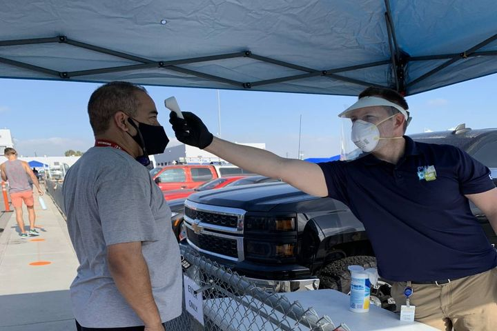 Attendees have their temperature taken before entering. - Photo: City of Long Beach