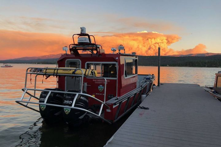 Lake Assault Boats has placed Fireboat 96 into service with the San Bernardino County Fire District (SBCFD) in California. The 28-foot long vessel serves on California's Big Bear Lake, and is similar to one stationed on the Colorado River. The massive Apple Fire is seen on the horizon. - Photo courtesy of SBCFD's Johnathan Duarte