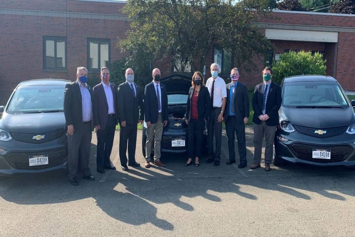 County and State officials stand by the three Chevrolet Bolt electric vehicles that were recently purchased by the County through a New York State Energy Research and Development Authority (NYSERDA) grant. - Photo: Chautauqua County