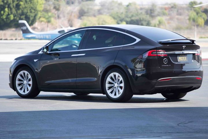 A Tesla Model X electric vehicle used by MOTEV luxury transportation service in Los Angeles. - MOTEV of Los Angeles