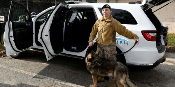 Staff Sgt. Autumn Smith, 78th Security Forces Squadron military working dog handler, and her...