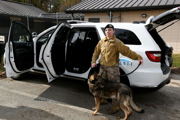 Staff Sgt. Autumn Smith, 78th Security Forces Squadron military working dog handler, and her working dog, Zorro, get ready for their patrol in their new modified K-9 SUV. - Photo:Joseph Mather, U.S. Air Force