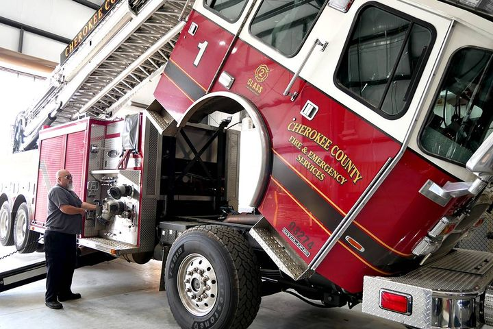 The new Fleet building allows fire apparatuses to be lifted completely for maintenance, giving Fire Truck Technician Larry Griffin the ability to do his job more efficiently. - Photo: Cherokee County Fleet Management