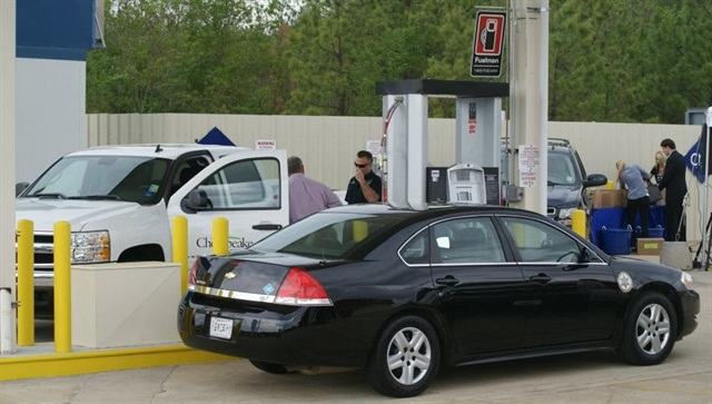 Pictured is one of 13 vehicles the Caddo Parish Sheriff's Office, nearby, has converted to run on CNG at the grand opening facility. Photo via Facebook/Time-It Lube.