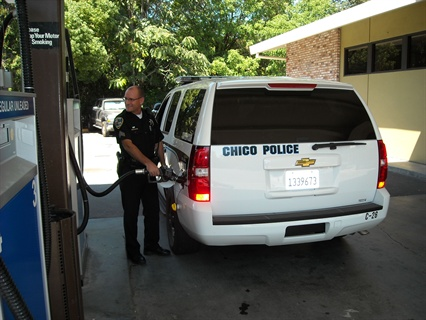 Sgt. Mike Nelson fuels his police vehicle, one of the 25 vehicles with AIM2 devices installed.