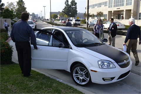 The CODA all-electric sedan was available after the meeting for test driving.
