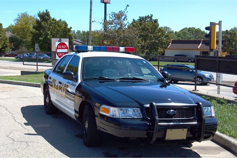 Deputies refuel the converted 2010 Ford Crown Victoria at a Charter Fuels autogas station, but Iowa County is looking into installing an on-site fueling station as it converts more vehicles.