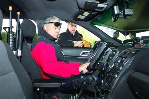 An attendee tries out a police vehicle at the Michigan State Police vehicle testing. Photo: Michigan State Police