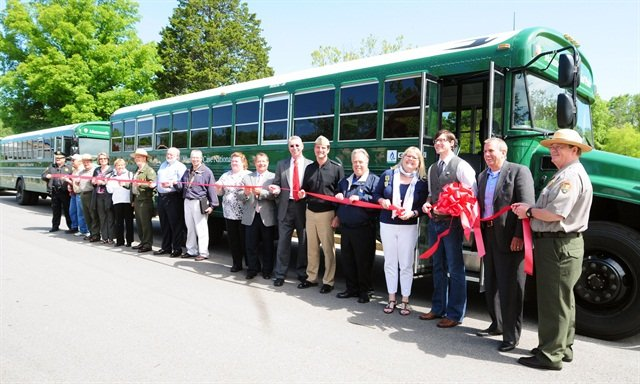 Mammoth Cave National Park Superintendent Pat Reed (far right) is joined by representatives from Forever Resorts of Scottsdale, Ariz.; National Renewal Energy Labs, Golden, Colo.; the Kentucky Clean Fuels Coalition; and the Kentucky Office of Adventure Travel to launch the new all-alternative fuel fleet at Mammoth Cave National Park. (Photo: Business Wire)