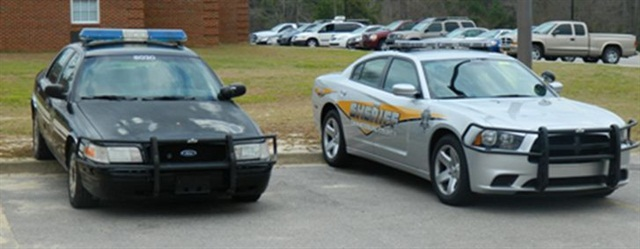The new Dodge Chargers (right) have a new look -- they're silver instead of black. Photo courtesy of Orangeburg County Sheriff's Office.