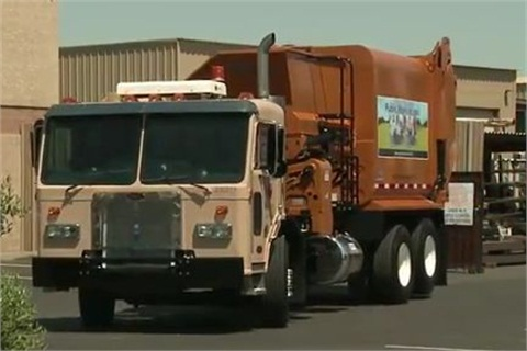 Shown is a refurbished garbage truck from the City of Phoenix. Photo via YouTube