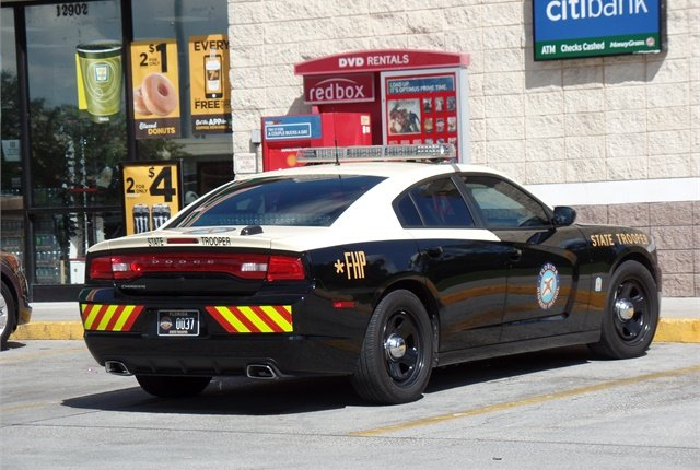 FHP's new patrol car is painted all black, trading in bright colored graphics and a light bar for discreet lettering. Photo via Flickr/Rich Menga