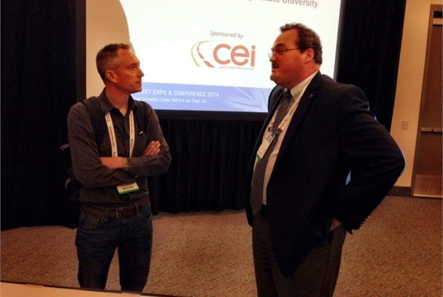 Kelly Reagan (right) speaks with a fleet manager after his CNG session. Photo by Paul Clinton.