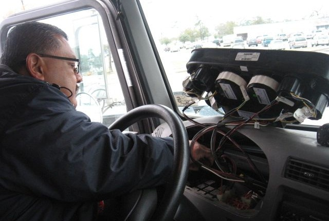 A technician installs a telematics device on one of the City of Houston's fleet vehicles. Photo courtesy of City of Houston