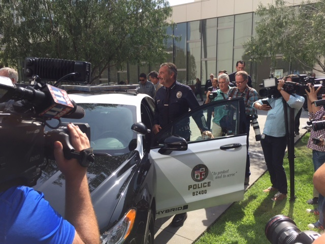 LAPD Chief Charlie Beck steps into the new hybrid patrol sedan. Photo by Chris Brown