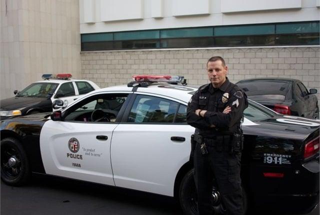 LAPD Sgt. Joel Miller poses next to an LAPD Dodge Charger Pursuit. Photo by Blake Bobit.