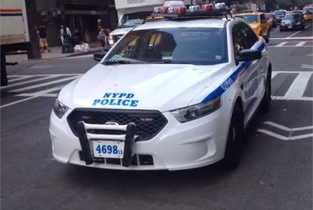 "The NYPD began using Ford P.I. sedans in the fall. Vehicle shown is not ""smart car."" Screenshot via Acepilot2k7/YouTube."