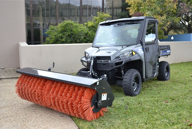 The Polaris Brutus HD PTO with powerbroom attachment can be used for sweeping, and with other attachments, it can be used for snow removal and mowing.