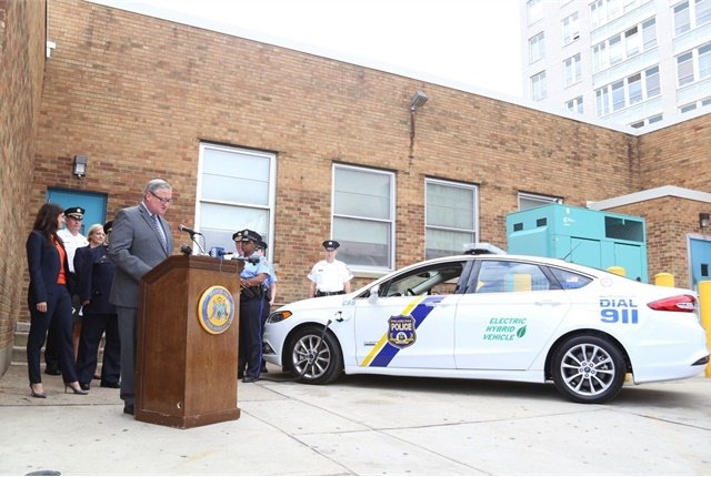 Mayor Jim Kenney is pictured at a news conference wih one of the plug-in hybrid vehicles. Photo courtesy of City of Philadelphia