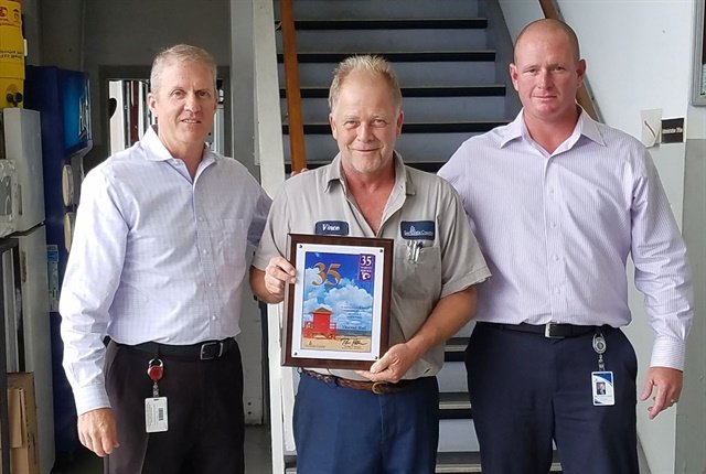 Vincent Hall is pictured at center with General Services Director Jeff Lowdermilk (left) and Fleet Manager Ron Kennedy (right). Photo courtesy of Sarasota County
