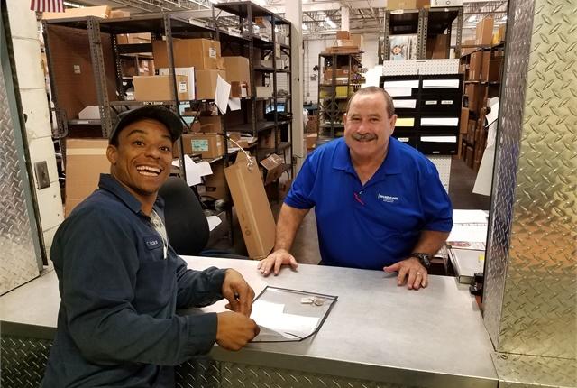 Pictured are Carlos Hicks, Tampa technician, and Porfirio Toro, MANCON parts specialist.Photo courtesy ofMANCON