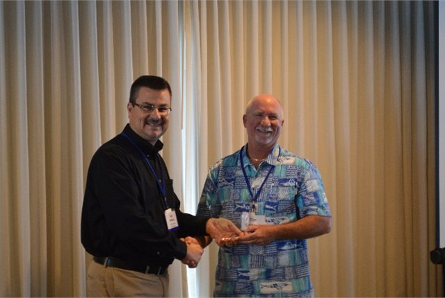 FLAGFA President Sean Williams recognized Past President Tim Calhoun at the event. Photo courtesy of FLAGFA