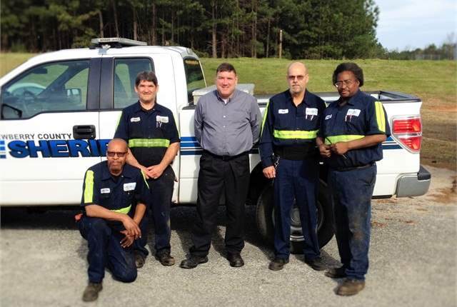 Vector's facility manager (center) and fleet technicians will continue to work on Newberry County vehicles. Photo courtesy of Vector Fleet Management