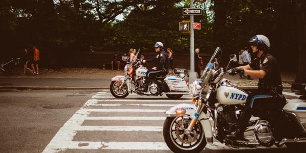 Policemotorcycle photo via Unsplash