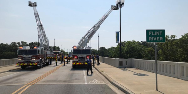 Albany held a ceremony debuting its new aerial trucks on a bridge over the Flint River.