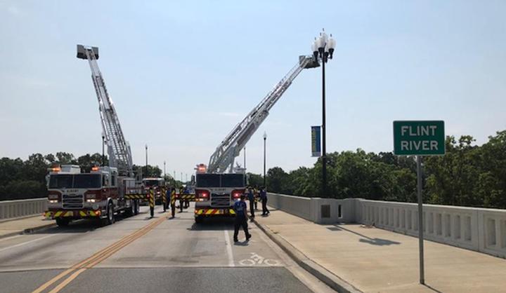 Albany held a ceremony debutingitsnew aerial trucks on a bridge over the Flint River.  - Photo courtesy of City of Albany