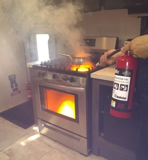 The kitchen-style classroom includes a training stove and custom fire extinguisher.