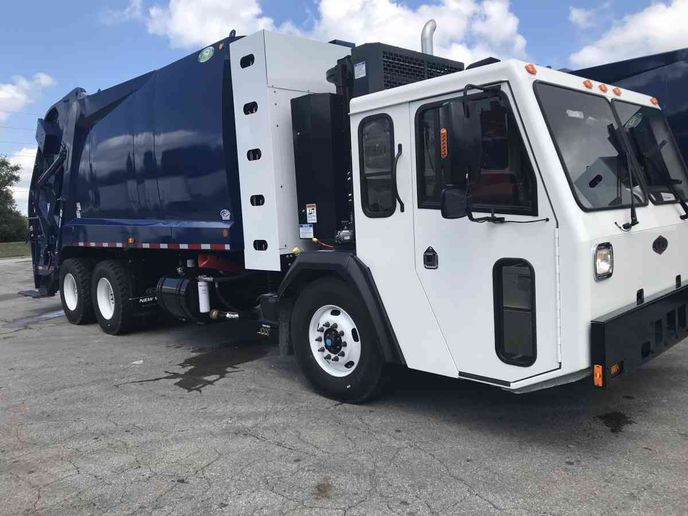 Twenty-four new trucks will join the city's current refuse fleet (pictured) next year.